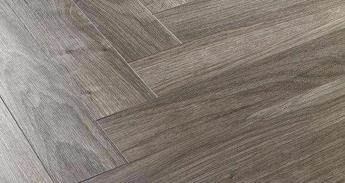 Vintage Chateau Herringbone - Light Grey Laminate Flooring - Descriptive 2