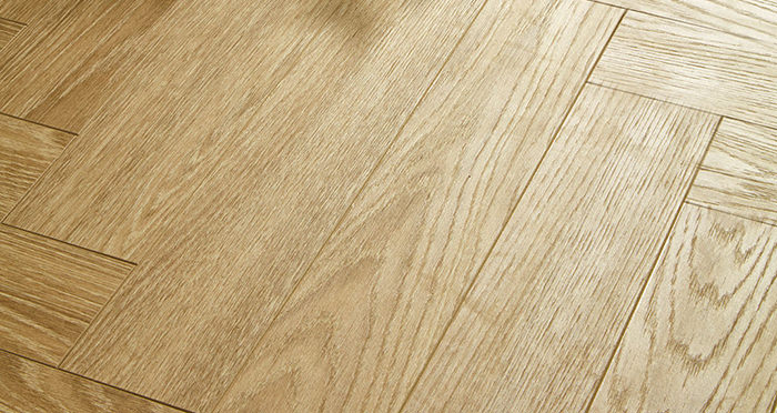 Vintage Chateau Herringbone - Light Almond Oak Laminate Flooring - Descriptive 2